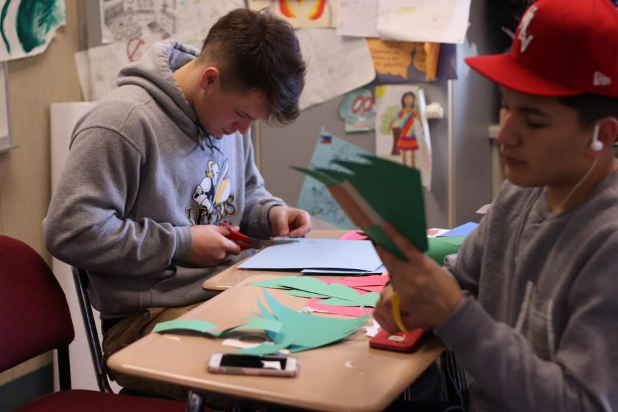 Nate Job and Ayden Ruminksi prepare for Winter Wishes 2017.