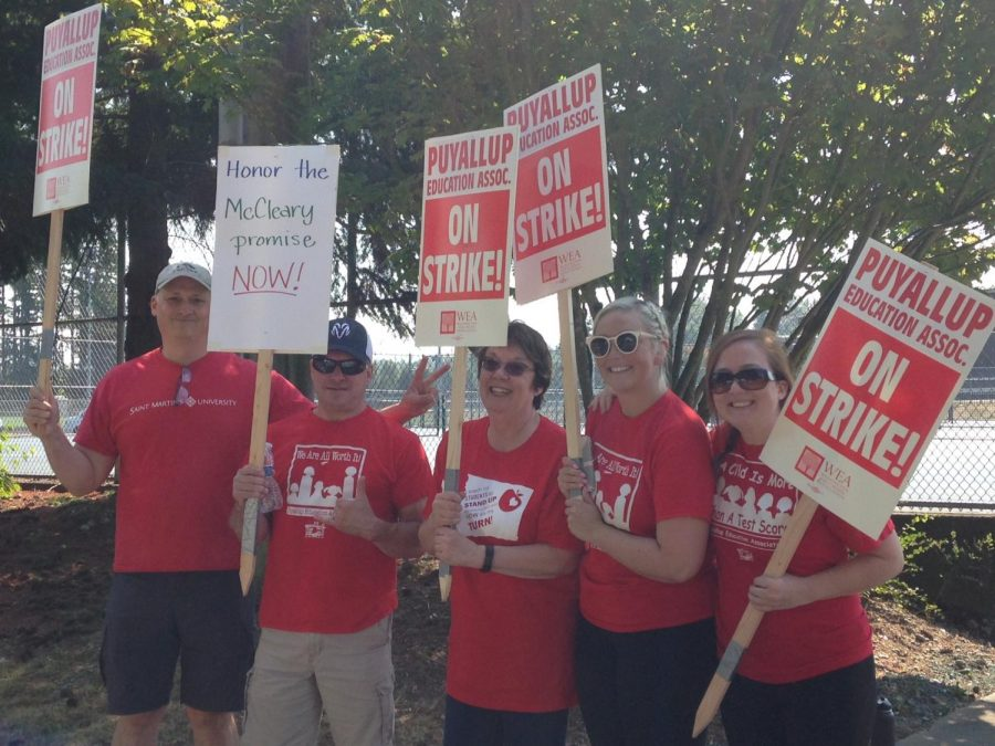 Teachers+Don+Clise%2C+Tony+Barager%2C+Diane+King%2C+Brittany+Langston%2C+and+Colleen+Pancake+picketing+outside+the+school+on+Sept.+5.+