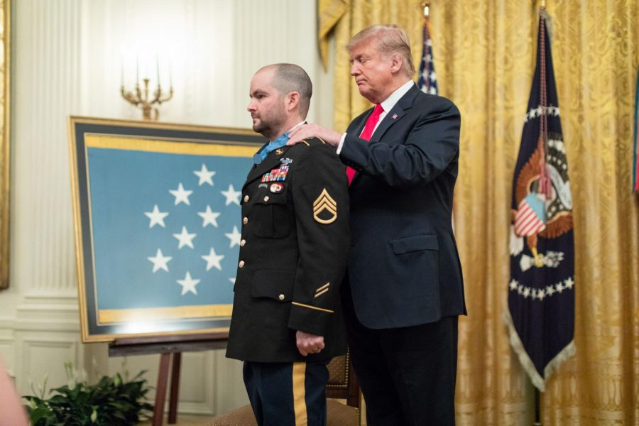Staff+Sergeant+Ronald+Shurer%2C+a+1997+RHS+graduate%2C+receives+the+Medal+of+Honor+from+President+Trump.