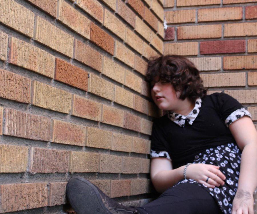 girl sleeping against Queen Anne Church